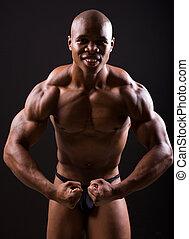 afrikaan, gespierd, bodybuilder, het poseren