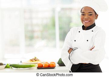 afrikansk amerikansk kvinna, kock, med, havsarm vek