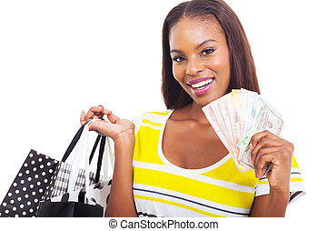 afrikansk kvinna, holdingen, a, hand, fyllda, av, kontanter