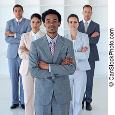 Afro-american business manager standing in office leading his team