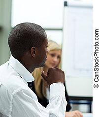 Afro-American businessman in a presentation