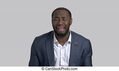 Afro-american businessman in full desperation. Dark-skinned...