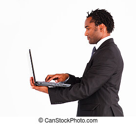 Afro-american businessman on a laptop