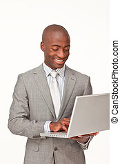 Afro-American businessman using a laptop