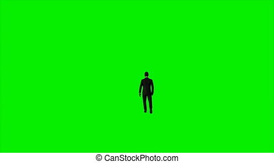 Afro american businessman walking against Green Screen