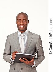 Afro-american standing businessman writing notes
