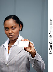 Afro-American businesswoman holding a business card