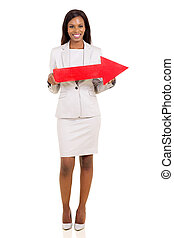 afro american businesswoman holding red arrow