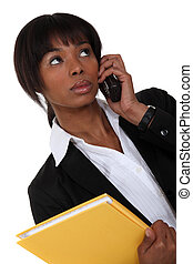 Afro-American businesswoman on the phone