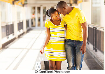 afro american couple in shopping mall - happy afro american...