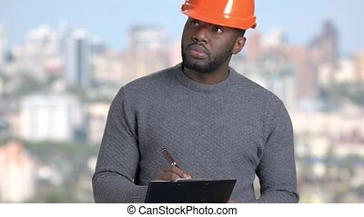 Afro-american foreman on blurred background....