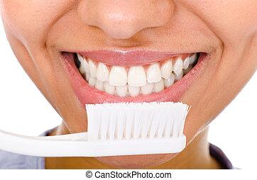 Afro-american girl brushing her teeth