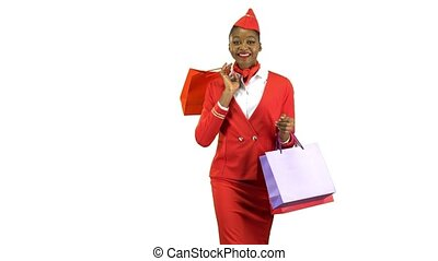 Afro american girl in a red suit comes with shopping bags she's a flight attendant. Alpha channel