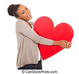 afro american girl holding heart shape