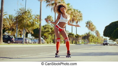 Afro American Girl on Roller Skates Standing on the Exotic...
