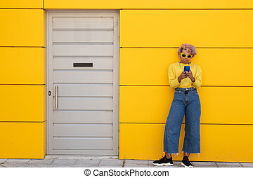 afro american girl with mobile phone on the street