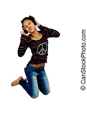 afro american jumping while listening to music with headphones
