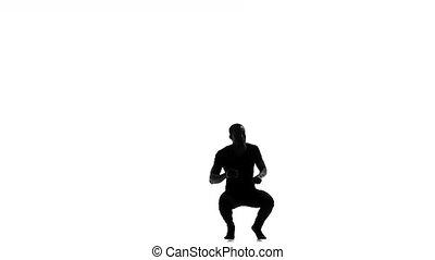 Afro american man dancer dancing barefoot latina dance on white, slow motion, silhouette