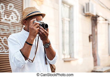 Afro american man making photo