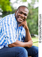 afro american man relaxing outdoors