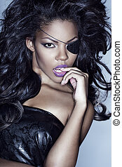 Afro american model with eye patch