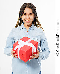 afro american smile woman with dreadlocks holding a big gift box