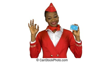 Afro american stewardess girl raises a card and shows a okey...