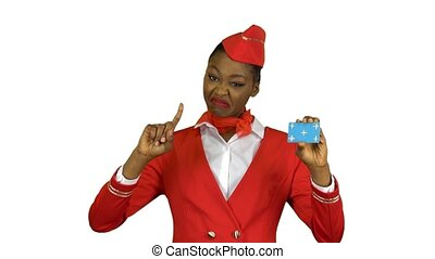 Afro american stewardess girl raises a card and shows a...