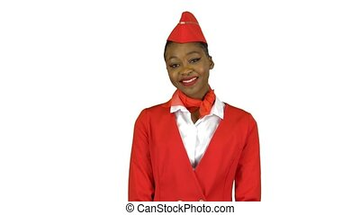 Afro american stewardess in a red outfit raises her head and smiles looks into the distance . Alpha channel