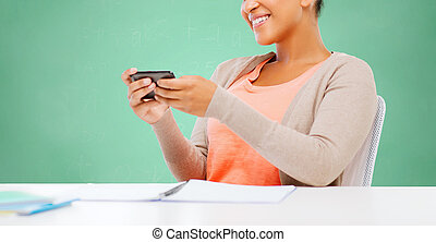 afro american student girl with smartphone