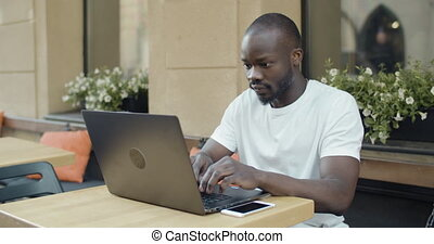 Afro American Student with Laptop - Young emotional afro...