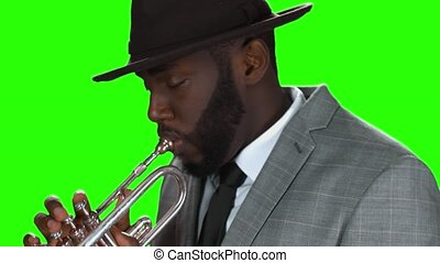Afro-american trumpet player. Trumpeter on chromakey...
