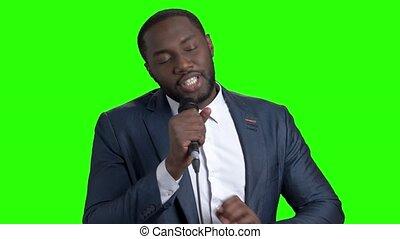 Afro-american tv presenter on green screen. Attractive...