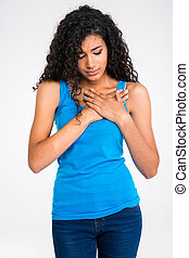 Afro american woman having pain in heart