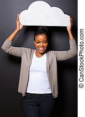afro american woman holding cut out paper cloud