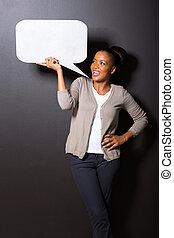afro american woman holding speech bubble