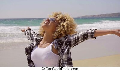 Afro-American Woman On The Beach - Young happy exotic woman...