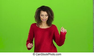 Afro american woman sexy dancing on green screen, slow motion