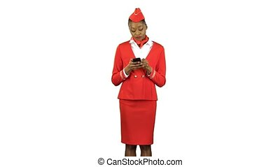 Afro american woman steps with the phone and writes a message, she is a professional flight attendant. Alpha channel