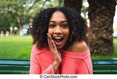 Afro american woman surprised expression