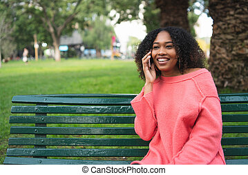 Afro american woman talking on the phone.