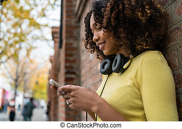Afro-American woman using mobile phone.