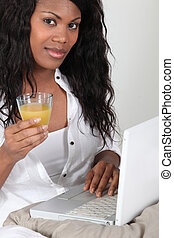 Afro-American woman with glass of