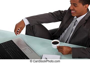 Afro-American worker having a break