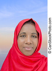 Afro beauty wearing a red headscarf