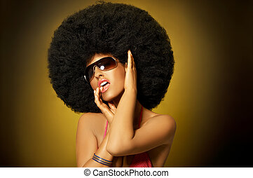 Afro Girl - Beautiful woman with huge afro haircut on yellow