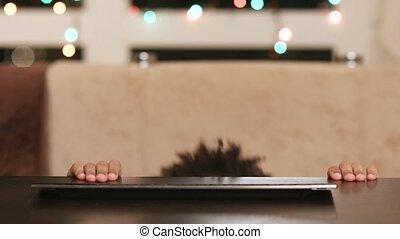 Afroamerican boy appears at keyboard.