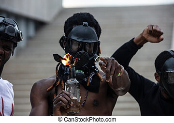 afroamerican men hold burning glass bottle in hands