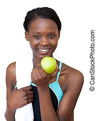 afroamerikansk, fitness, kvinna ätande, en, äpple