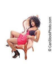 afrykańska amerykańska kobieta, posiedzenie, w, armchair.